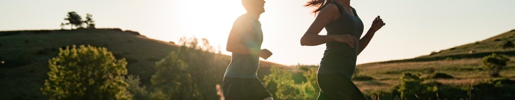 Couple running in the countryside