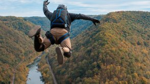 Base jumping over fall foliage and river
