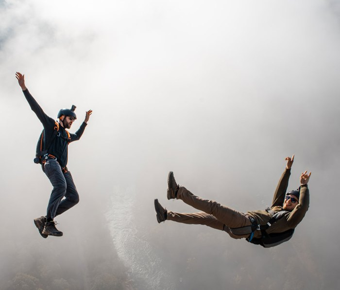 BASE jumpers free falling through clouds