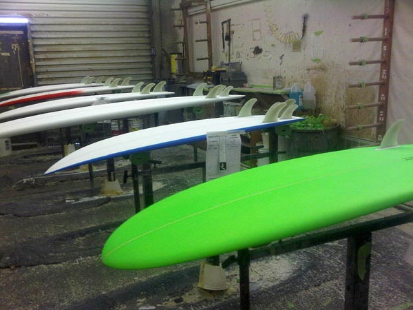 What was interesting to me was the fact that boards with Futures Fins setup were glassed first, then the fin boxes were cut into the boards using a router. The boards with FCS fin setups were in an entirely different room.