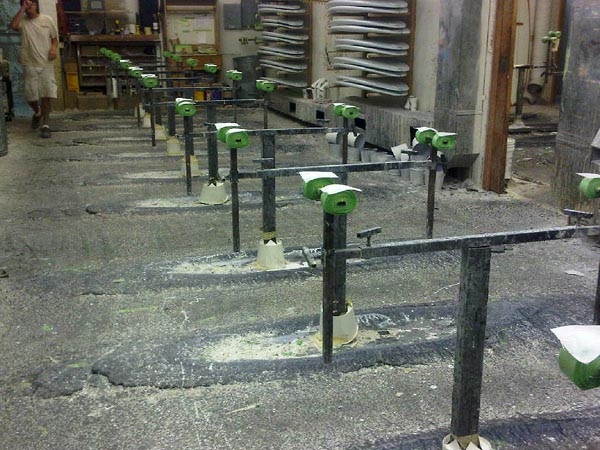 These are the racks that are used to hold up boards as they get glassed. These were full of freshly glassed boards when I arrived. Every year some kid has the glorious job of hammering out the built-up resin.