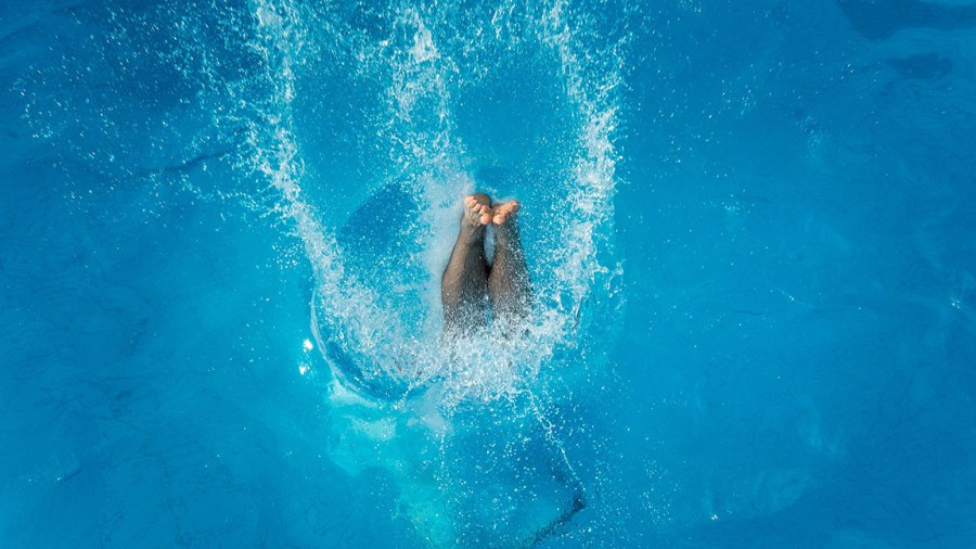 A man dives into the water after a jump from the 3 meter platform at the swimming pool 'Muehltalbad' on July 03, 2015 in Darmstadt, Germany. Temperatures across northern Europe are rising and in Germany a high of 37 degrees Celsius is forecast for the weekend. (Photo by Thomas Lohnes/Getty Images)