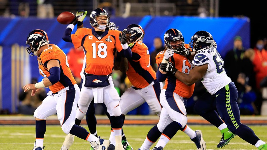 EAST RUTHERFORD, NJ - FEBRUARY 02: Quarterback Peyton Manning #18 of the Denver Broncos looks to pass in the fourth quarter against the Seattle Seahawks during Super Bowl XLVIII at MetLife Stadium on February 2, 2014 in East Rutherford, New Jersey. (Photo by Rob Carr/Getty Images)