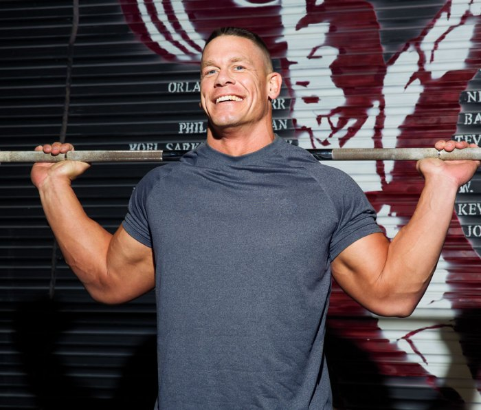 John Cena with barbell on shoulders