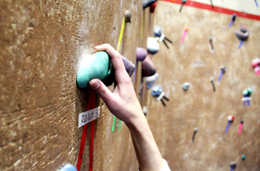 First find the route with the right rating, then follow that color up the wall. Photo by Brandon Scherzberg.