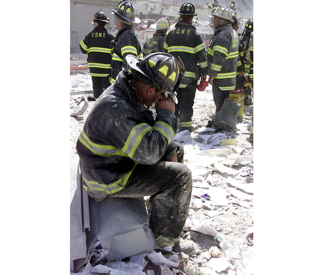 New York Fire Department rescue workers devastated at the site of the attacks