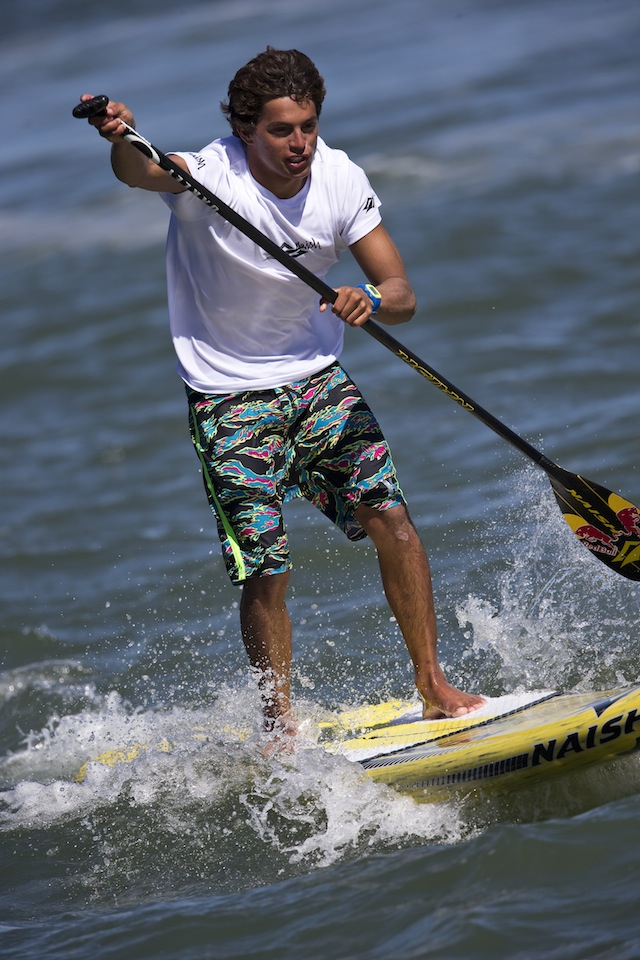 Kai Lenny competes in all three types of standup paddleboarding competitions: wave riding, long distance, and race style events. Photo courtesy of Red Bull