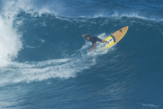 Kai Lenny paddle surfs at Jaws in 2012. Photo courtesy of Red Bull