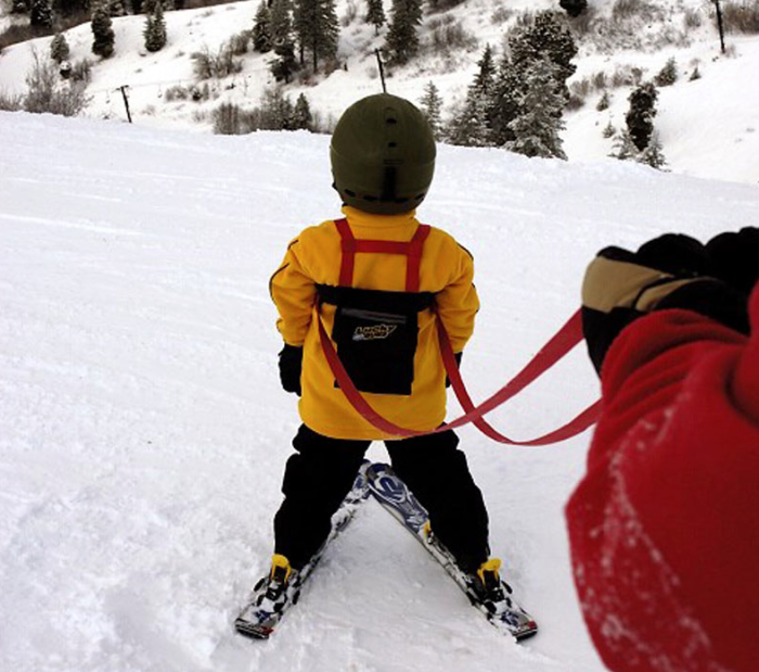 Getting your kids snowboarding and skiing: A nice ski-harness will keep things safe as you teach your kids to hit the slopes.