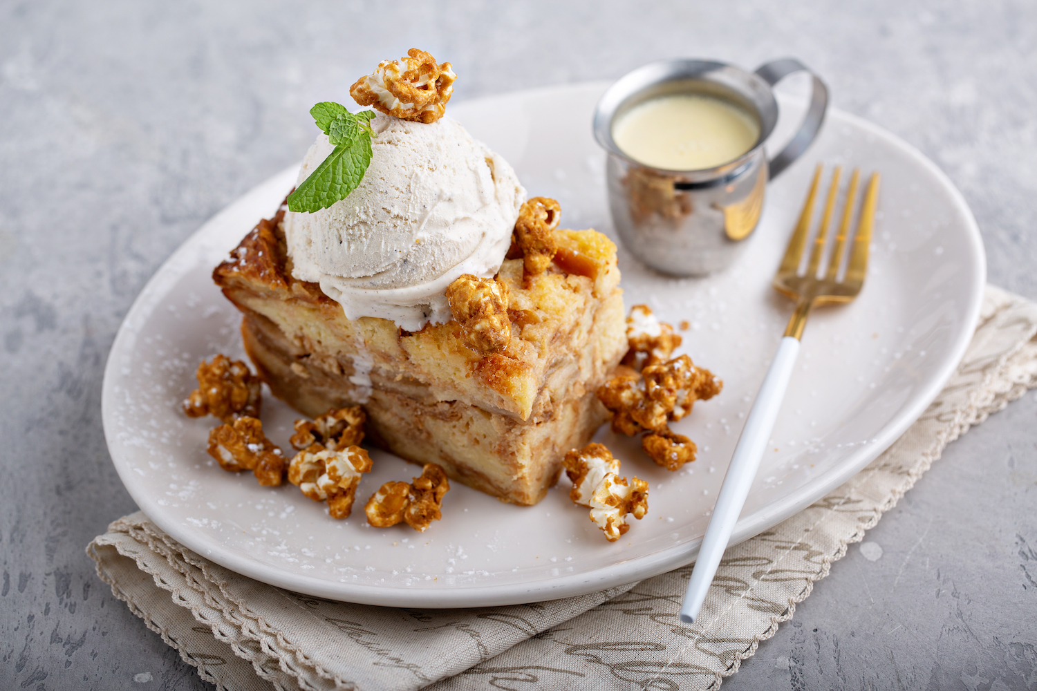 Caramel apple bread pudding with ice cream and popcorn, fall dessert.