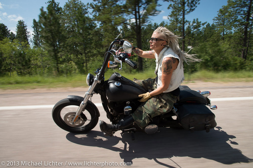 Women on motorcycles: Masyn Moyer and her bike; photo by Michael Lichter