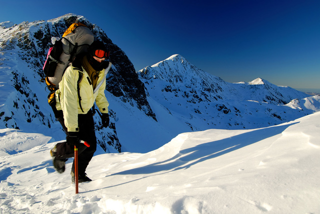 A solid hardshell can be just as effective on a morning jog as it can be for an excursion in the high alpine;Mountain image courtesy of Shutterstock.