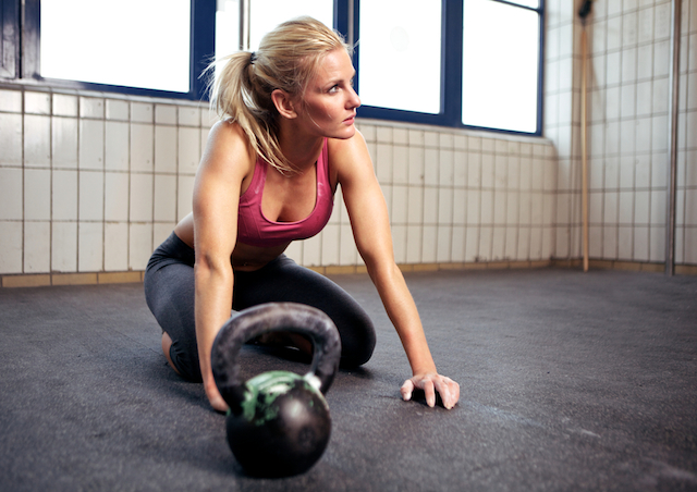 Kettlebells don't have to be frustrating, learn the basics and you'll be toning up in no time. Photo of girl with kettlebell courtesy of Shutterstock.