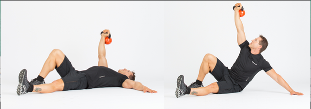 The turkish half getup is a great workout for your core. Photo courtesy of KettleWorx.