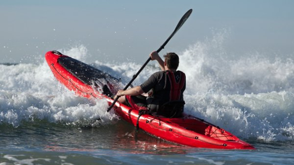 Wilderness Systems' new offshore fishing kayak taking on big surf.