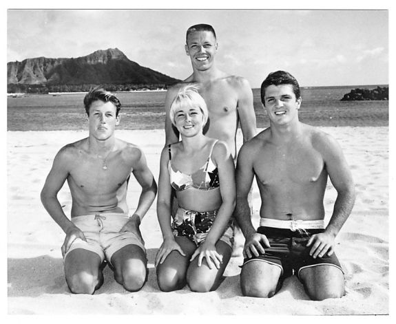 Hobie (top) posing with his team riders Mike Haley, Linda Benson, and Dave Willingham in Waikiki. Circa 1960. Photo: Courtesy Clarence Maki Family