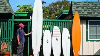 surfer/shaper Ryan Burch with a quiver's worth of asymmetrical surfboards; photo by Aaron Checkwood/TransWorld SURF