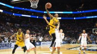 CHARLOTTE, NC - MARCH 16: Jairus Lyles #10 of the UMBC Retrievers drives to the basket during the first round of the 2018 NCAA Men's Basketball Tournament against the Virginia Cavaliers at the Spectrum Center on March 16, 2018 in Charlotte, North Carolina. The Retrievers won 74-54. Photo by Mitchell Layton/Getty Images) *** Local Caption *** Jairus Lyles