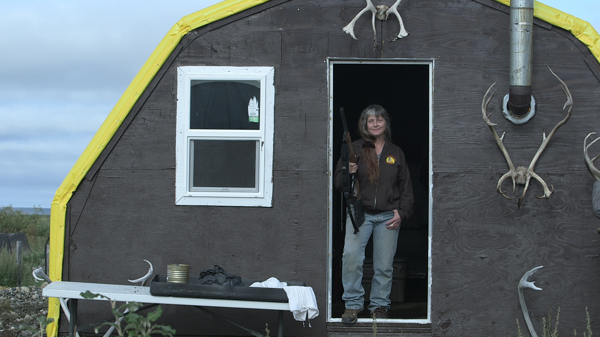 """""""Life Below Zero"""" star Sue Aikens at the door of her tent at Kavik River Camp; photo courtesy National Geographic"""