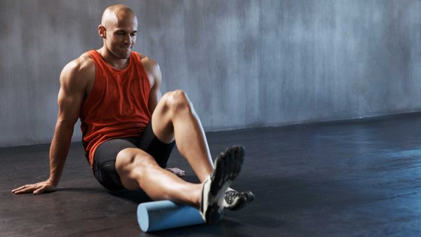Man foam rolling his calves