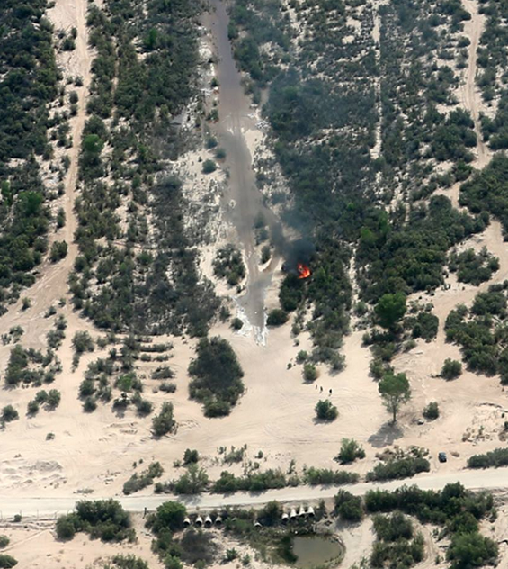Water arrives at Vado de Carranza, a road crossing about 60 river miles below the Morelos Dam, on April 9. The red splotch is a garbage fire. Photo courtesy of the Sonoran Institute.