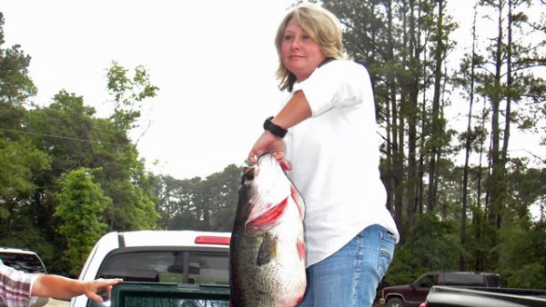 Regina Womack with her 15.88-pound bass, caught in May 2010 at Valentine Lake, Louisiana.