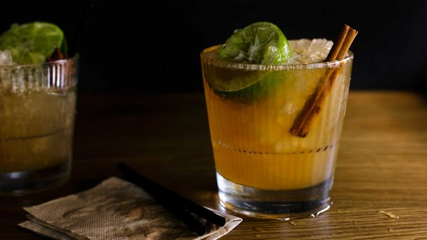 Cocktail with Crushed Ice, Lime, and Cinnamon