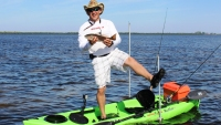 Locked in place: the Swivel Stick double-anchored on a slender kayak not typically used to stand.