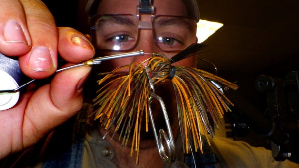 Use fly tying tools to make that fussy job of tying on jig skirts go down easy.