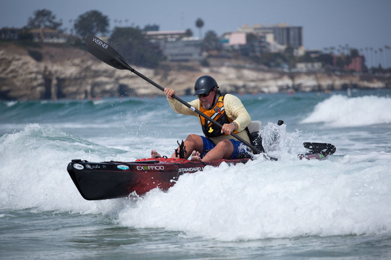 The trick to landing is to AVOID the surf as much as possible, to protect your expensive fishing gear. Notice Jim is paddling in right behind a foamer.