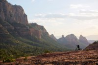 A man rides his enduro-style mountain bike at the end of the day in Sedona, Arizona, USA.