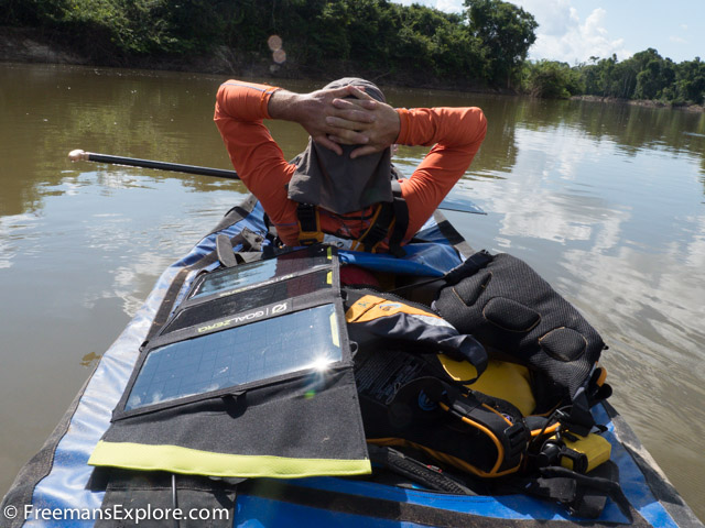 Paul Schurke soaks up the sun along with one of the team's solar panels during a brief rest on the Rio Roosevelt. The team used GoalZero solar panels and battery packs to power all of their cameras and communication equipment during their five weeks on the river. Photo Dave Freeman