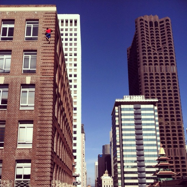 Alex Honnold climbing a brick building in San Francisco. Photo from Alex Honnold's Facebook page