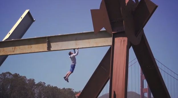 Alex Honnold climbing the Mark di Suvero sculpture. Photo is a screen grab from the video