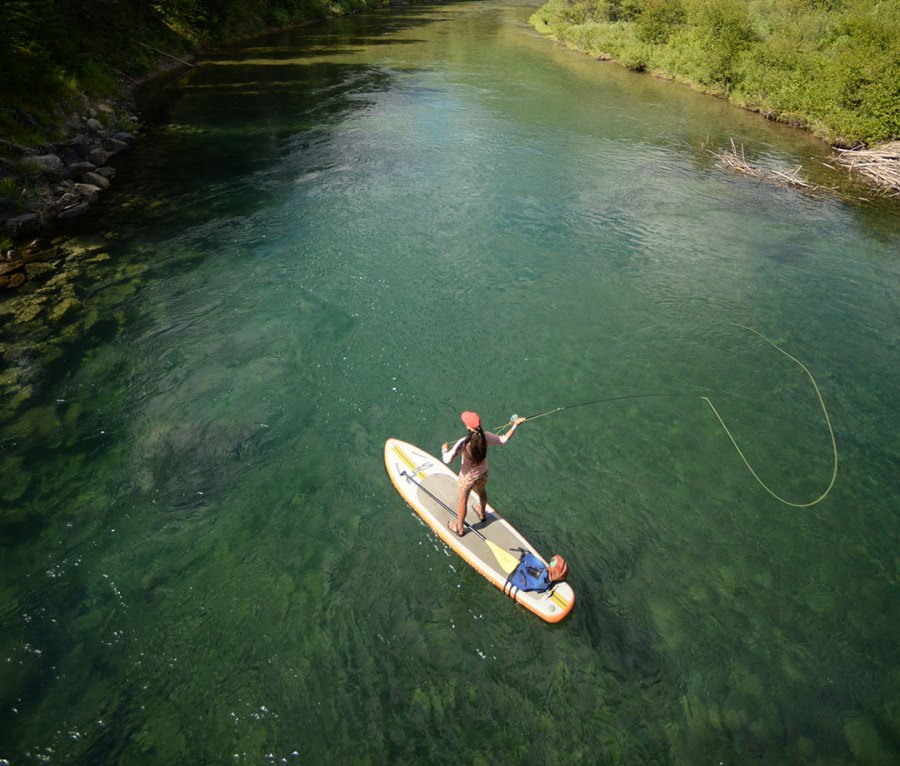 Fly-fishing from a stand-up paddleboard in Montana