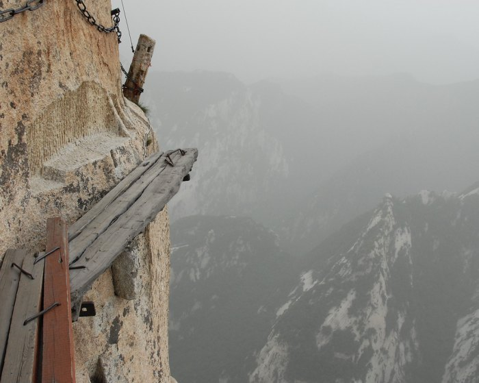 World's most dangerous hikes include the cliffside plank path on Mt. Huashan in China. Photo by Aaron Feen/Flickr