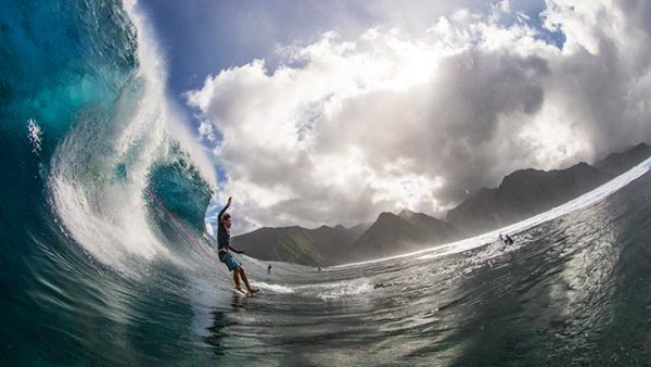 Unidentified taking the plunge at Teahupo'o; photo by Noyle/Surfer mag