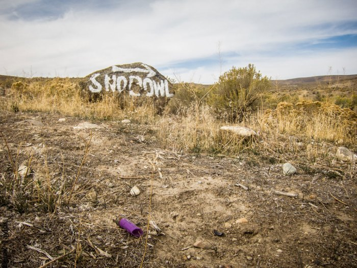 The fact that the sign for Elko SnoBowl is a rock on the ground says something about their annual snowfall—and the need for the updated snowmaking system the ski hill is trying to buy. Photo: Derek Taylor