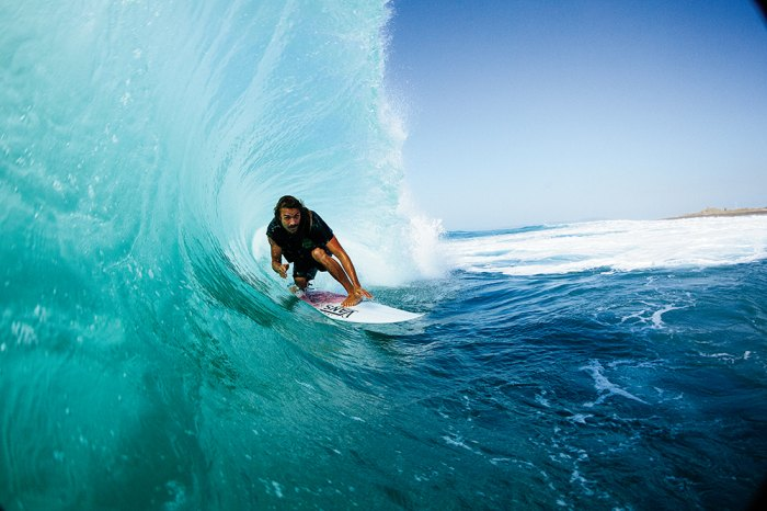 Dylan Graves pulls in to a nice Jamaican tube. Photo: Grant Ellis/Surfer Magazine