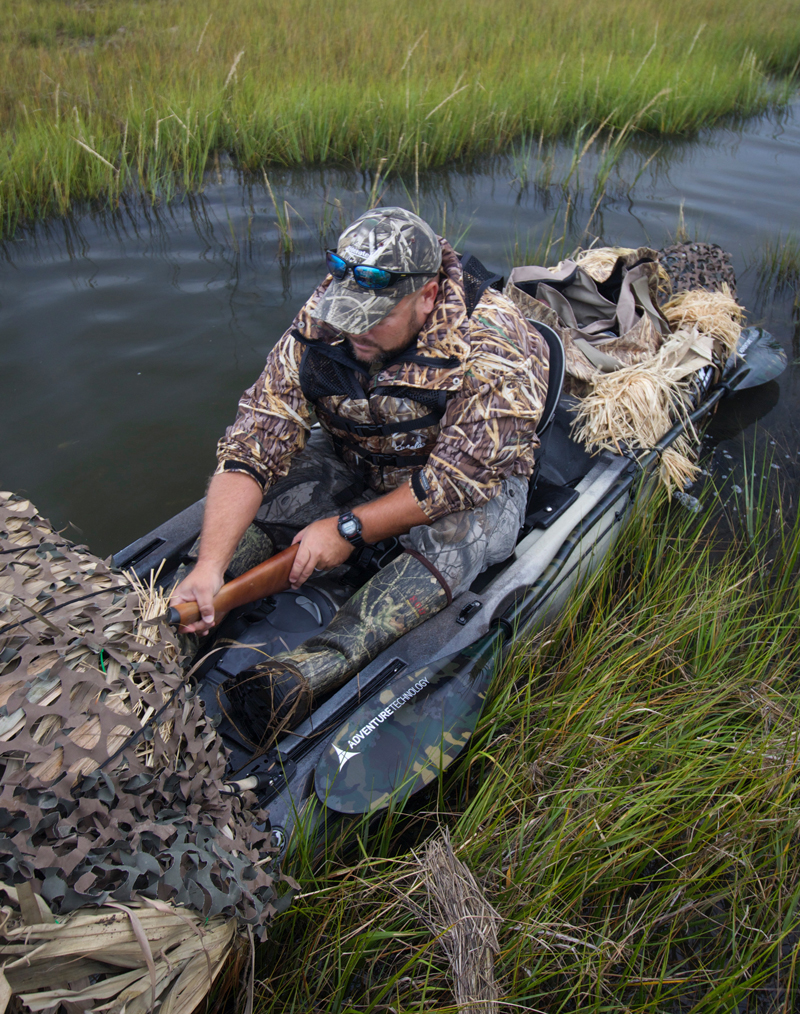 Kayak waterfowl hunter Adam Corry gets comfortable in his camouflaged Wilderness Systems Ride 135.