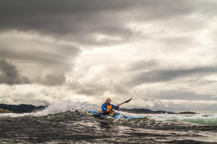 Paddler Nathaniel Stephens on the Pacific Coast of Chichagof Island. Photo taken from the kayak.
