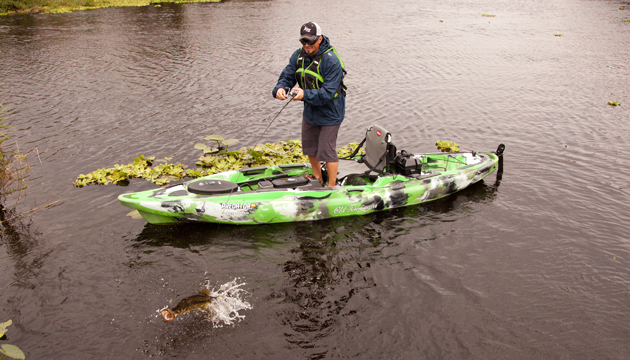 Stand-up stability: camera boat operator Troy Faletra takes his turn on the XL. Paul Lebowitz photo.