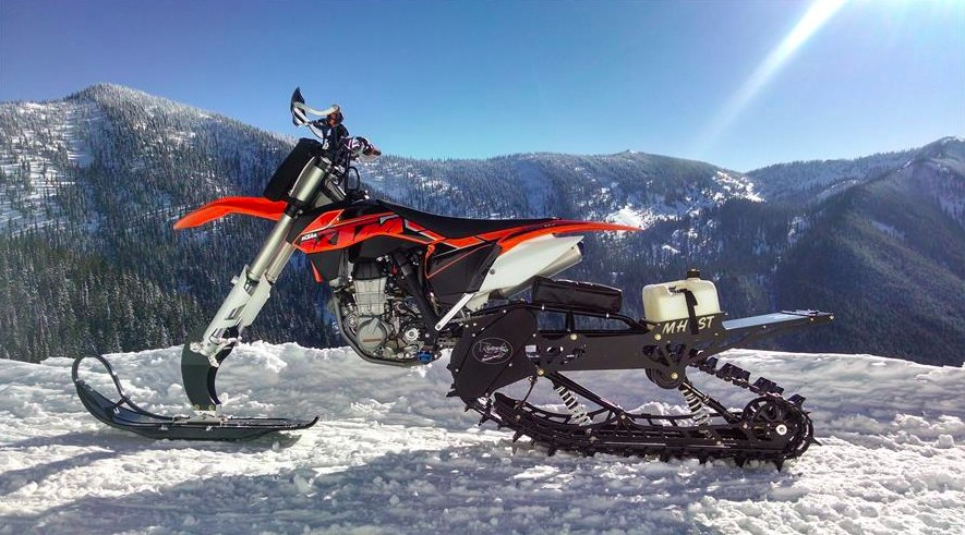 A Timbersled snow bike kit on the back of a KTM. Photo by Timbersled