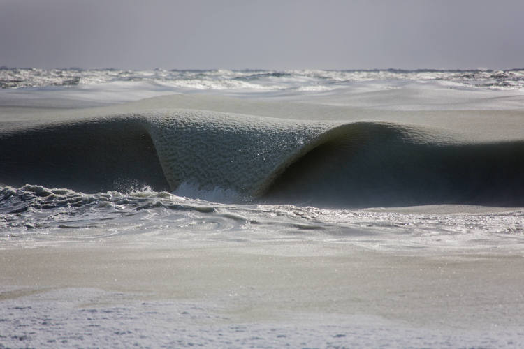 Frozen waves are photographed on Nantucket, Massachusetts. Photo by Jonathan Nimerfroh used by permission