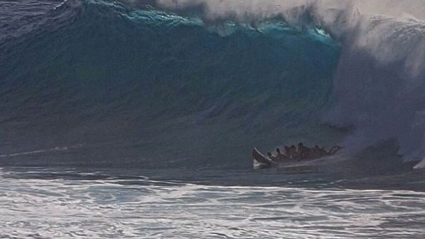 Seven surfers catch a 17-foot wave in Makaha, Hawaii, on a Supsquatch. Photo is a screen grab from the video