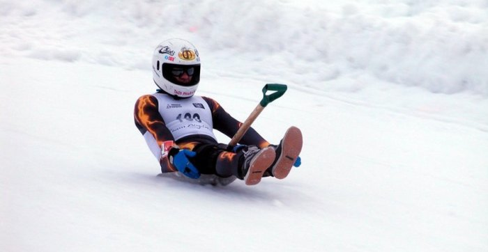 Shovel racing, once a Winter X Games sport, involves sliding down a luge on a snow shovel; Photo courtesy of Angel Fire Resort