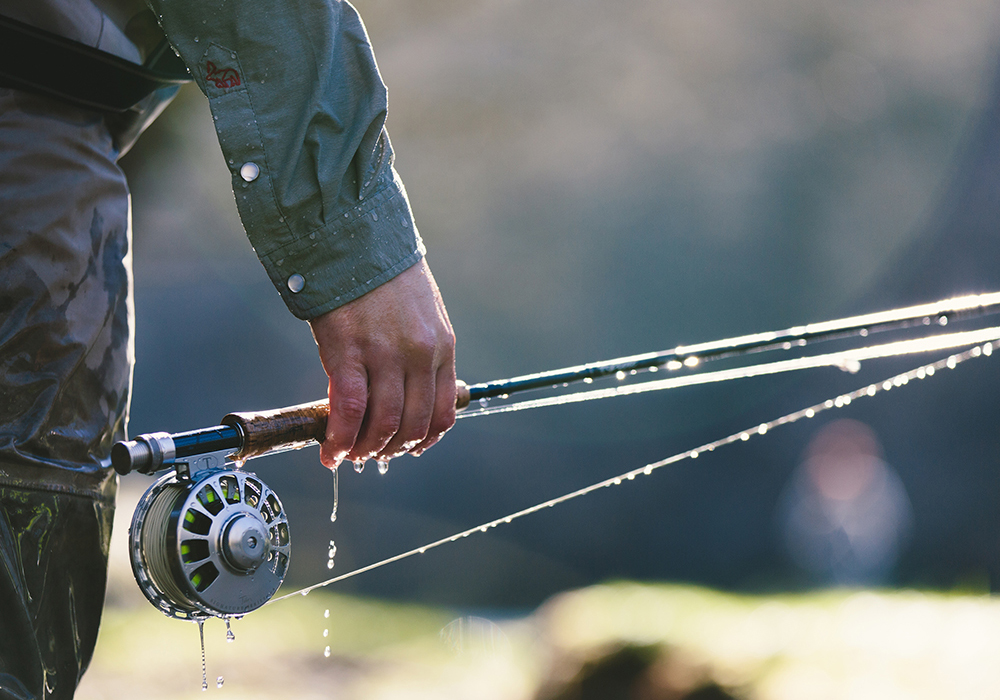 All you need to start fly fishing? A rod, reel, line, tippet and fly; Photo by Tony Czech