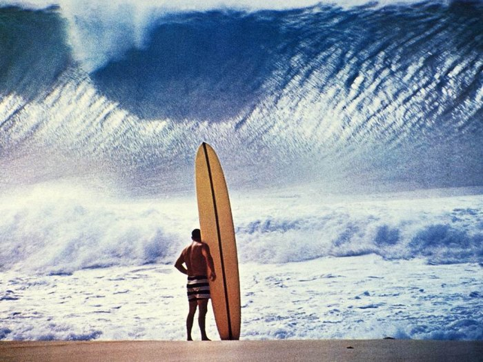 The iconic image of Greg Noll and his board at Pipeline. Photo Jon Severson