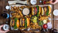 Spread with cheeseburgers and French fries