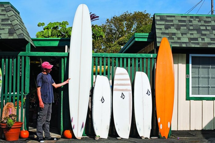 Ryan Burch shows off his self shaped asymmetric surfboards. Photo: Aaron Checkwood / TransWorld SURF
